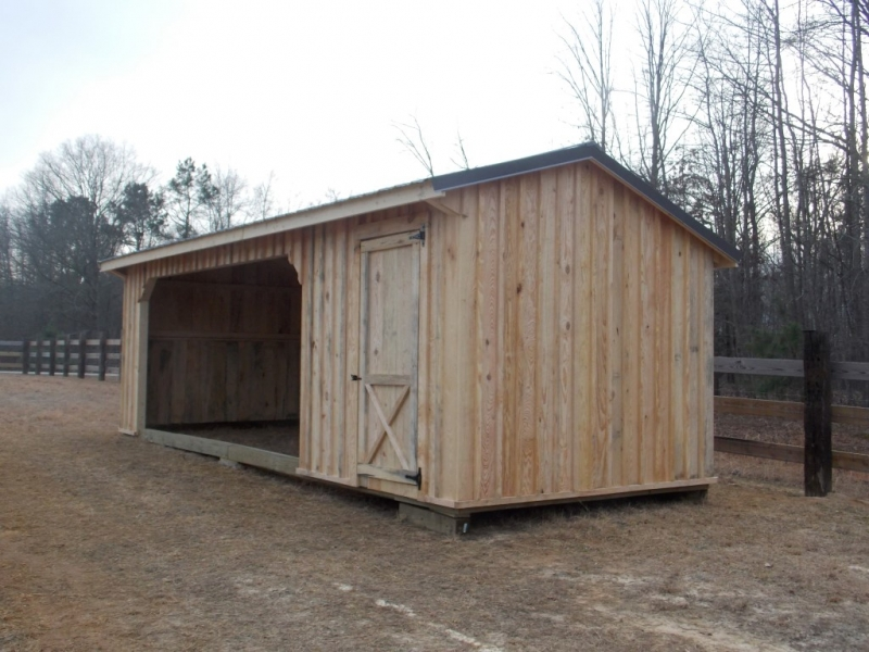 10x26 foot horse run in with a 6x10 foot tackroom with metal roofing and board and batten siding