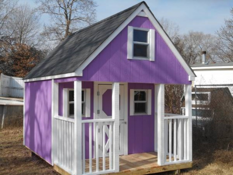 Cottage playhouse with a loft